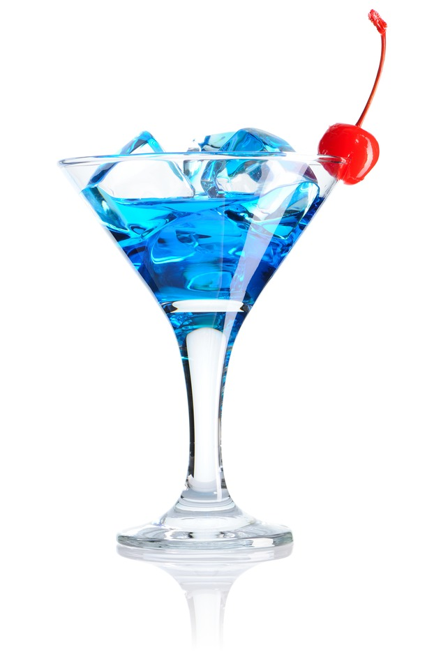 Blue cocktail with red cherry